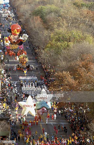 Marching band followed by turkey float and Mickey Mouse balloon during the 2000 Macy's Thanksgiving Day Parade