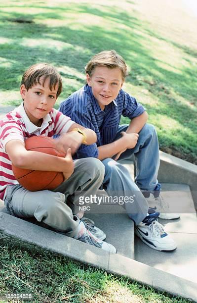 Pictured: Max Elliott Slade as Kevin Buckman, Leonardo DiCaprio as Garry Buckman