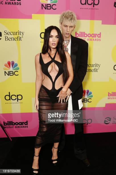 Pictured: Megan Fox and Machine Gun Kelly arrive to the 2021 Billboard Music Awards held at the Microsoft Theater on May 23, 2021 in Los Angeles,...