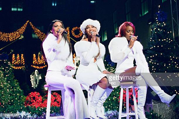 Michelle Williams Beyonce Knowles Kelly Rowland of Destiny's Child perform during the Christmas tree lighting at Rockefeller Center on November 29...