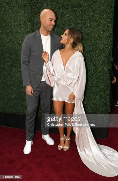 Mike Caussin and Jana Kramer arrive to the 2019 E People's Choice Awards held at the Barker Hangar on November 10 2019 NUP_188992