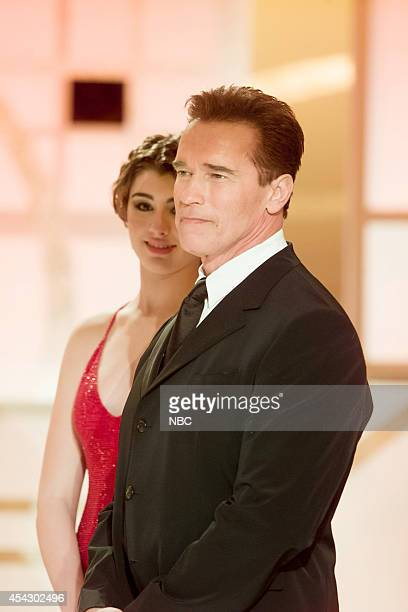 Miss Golden Globe Dominik GarciaLorido and Arnold Schwarzenegger are seen on stage at the 60th Annual Golden Globe Awards held at the Beverly Hilton...