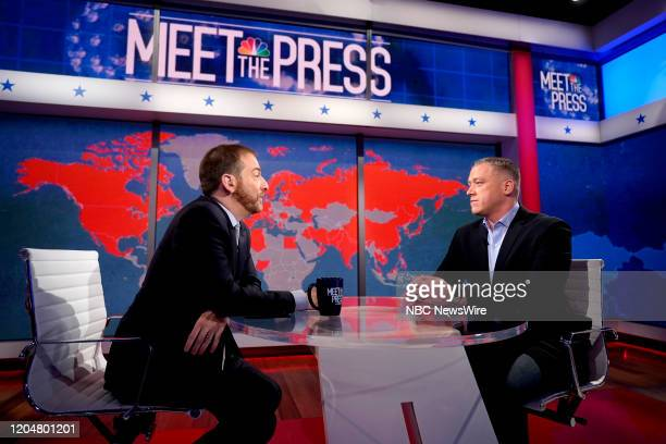 """Pictured: Moderator Chuck Todd; Dr. Joseph Fair, NBC News Medical Contributor appear on ?Meet the Press"""" in Studio 6A at Rockefeller Center in New..."""