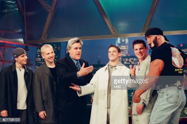 Musical group 98 Degrees host Jay Leno and professional wrestler Hulk Hogan pose for a photo on April 9 1999
