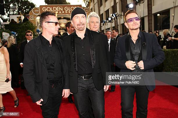 Pictured Musicians Larry Mullen Jr The Edge Adam Clayton and Bono of U2 arrive at the 71st Annual Golden Globe Awards held at the Beverly Hilton...