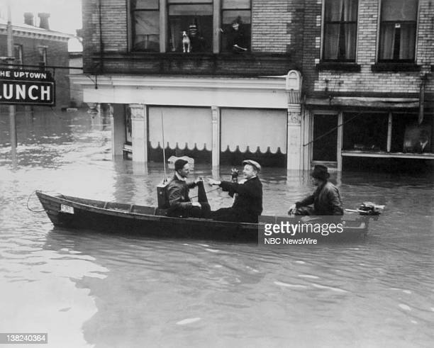 NBC News Mobile Radio units reporting aboard row boats as they traveled through the flooded city of Portsmouth Ohio on January 26 1937