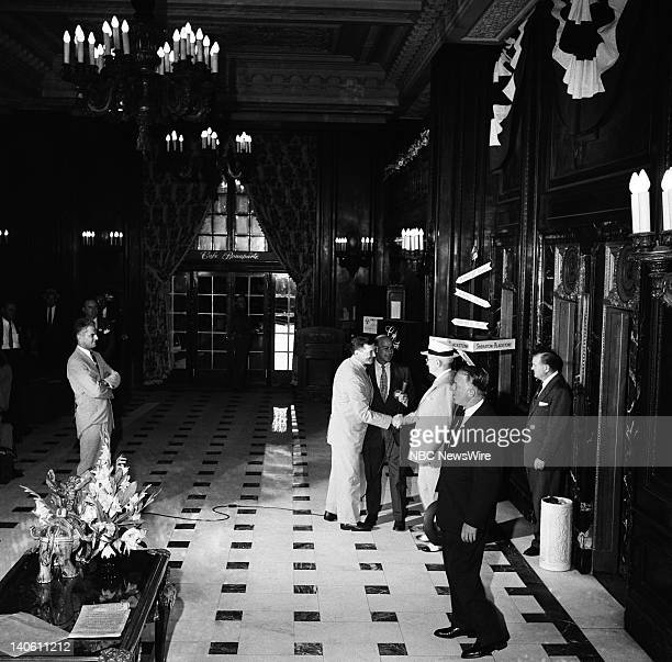 Pictured: NBC News' Paul Cunningham, NBC News' Joe Michaels greet Former President of the United States Harry S. Truman in the lobby of the Sheraton...