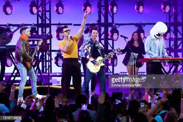 Pictured: Nick Jonas, Joe Jonas, and Kevin Jonas of Jonas Brothers perform with Marshmello on stage during the 2021 Billboard Music Awards held at...