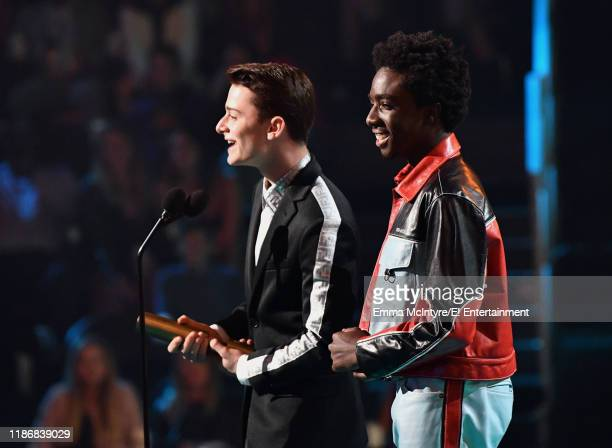 Noah Schnapp and Caleb McLaughlin accept The TV Show of 2019 award for 'Stranger Things' on stage during the 2019 E People's Choice Awards held at...