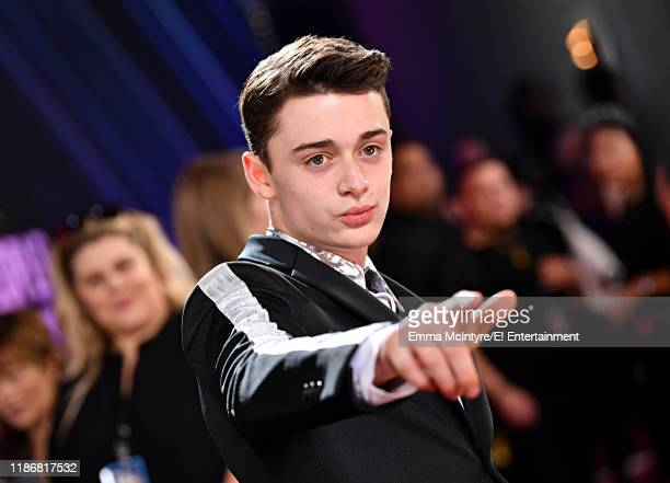 Noah Schnapp arrives to the 2019 E People's Choice Awards held at the Barker Hangar on November 10 2019 NUP_188994