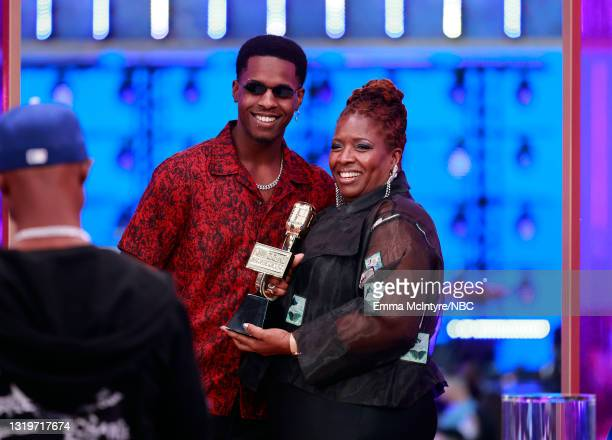 """Pictured: Obasi Jackson and Audrey Jackson accept Top Billboard 200 Album for """"Shoot for the Stars, Aim for the Moon"""" on behalf of Pop Smoke during..."""