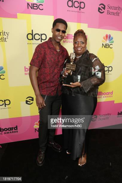 Pictured: Obasi Jackson and Audrey Jackson pose with awards on behalf of Pop Smoke -- Top New Artist, Top Rap Artist, Top Rap Male Artist, Top...