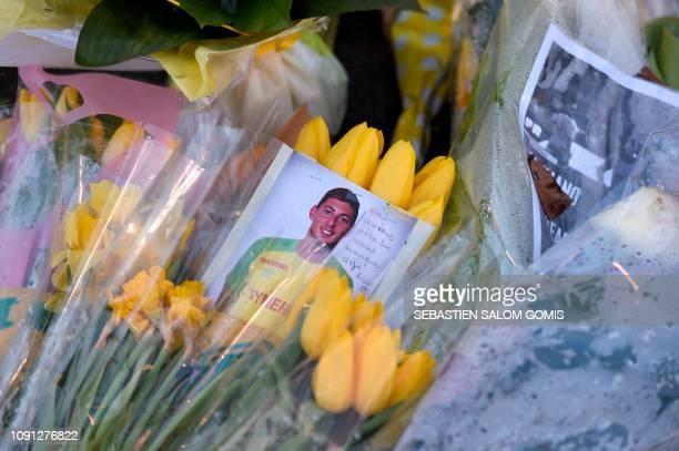 Pictured of Nantes' Argentinian forward Emilianio Sala is places amongst flowers in front of a giant portrait of Nantes' Argentinian forward...