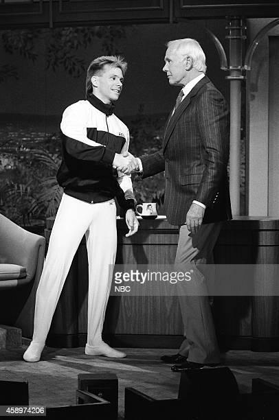 Olympic gymnast Kurt Thomas and host Johnny Carson on May 10 1990