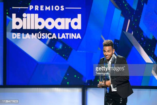 "Pictured: Ozuna, winner of the ""Latin Rhythm Artist of the Year, Solo"" award, speaks at the Mandalay Bay Resort and Casino in Las Vegas, NV on April..."
