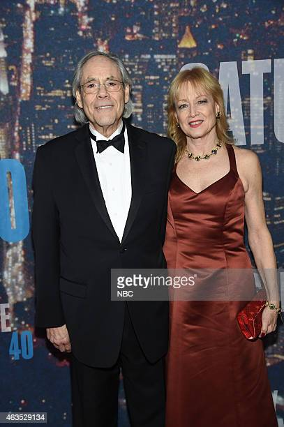 Robert Klein and guest walk the red carpet at the SNL 40th Anniversary Special at 30 Rockefeller Plaza in New York NY on February 15 2015