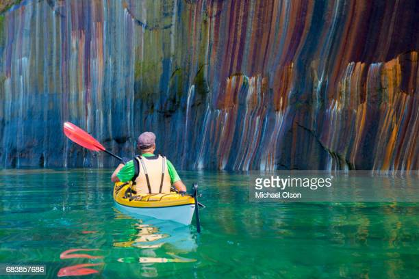 pictured rocks kayaker colored cliff - pictured rocks national lakeshore stock pictures, royalty-free photos & images