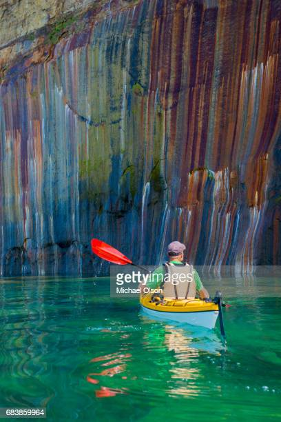 pictured rocks kayaker colored cliff vertical - pictured rocks national lakeshore stock pictures, royalty-free photos & images