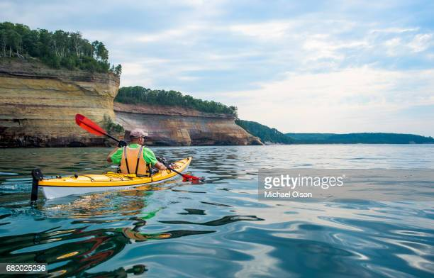 pictured rocks national lakeshore kayaker - lake superior stock pictures, royalty-free photos & images