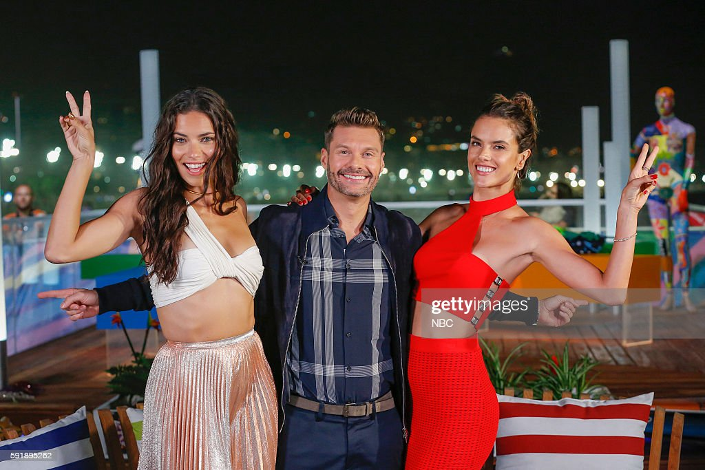 Ryan Seacrest (center) poses with models (l-r) Adriana Lima and Alessandra Ambrosio on August 8, 2016 --