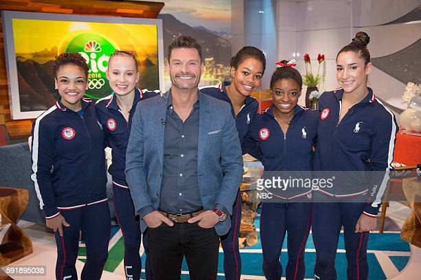 Ryan Seacrest poses with US Gymnasts Laurie Hernandez Madison Kocian Gabby Douglas Simone Biles and Aly Raisman on August 4 2016