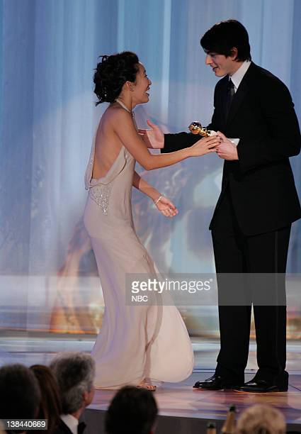 Sandra Oh and Brandon Routh on stage during The 63rd Annual Golden Globe Awards at the Beverly Hilton Hotel