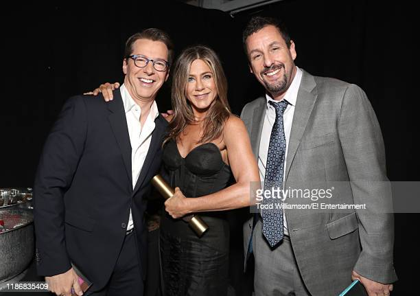 Sean Hayes Jennifer Aniston and Adam Sandler pose backstage during the 2019 E People's Choice Awards held at the Barker Hangar on November 10 2019...