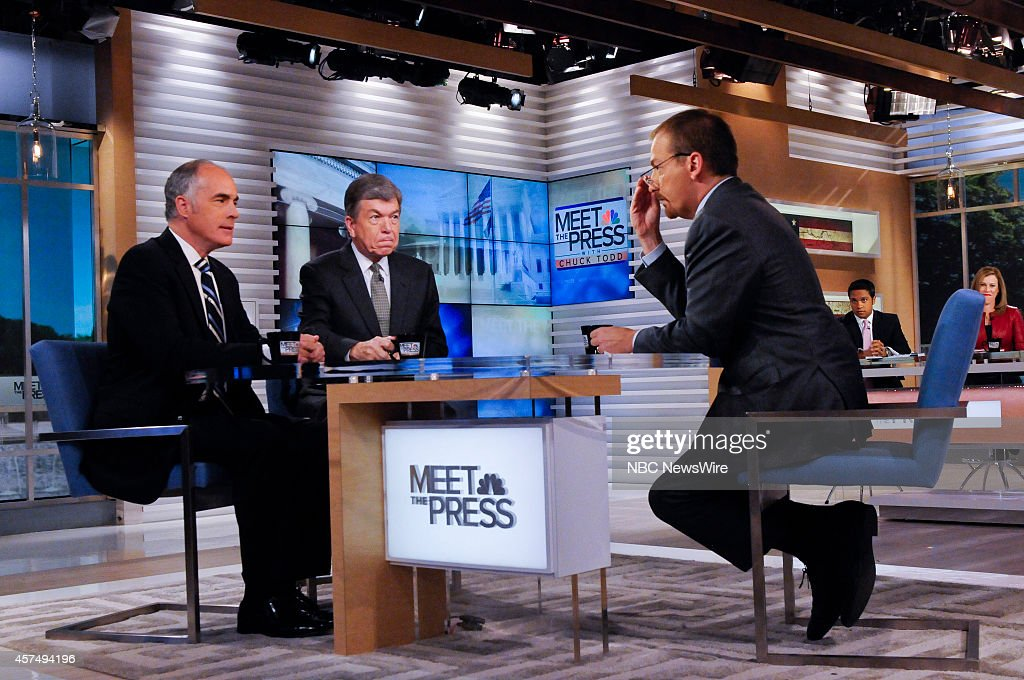 Sen. Bob Casey (D-PA,) Sen. Roy Blunt (R-MO) and moderator Chuck Todd appear on 'Meet the Press' in Washington, D.C., Sunday, Oct. 19, 2014.