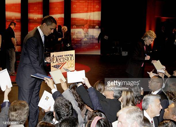 Senator Barack Obama and Senator Hillary Rodham Clinton sign autographs after the Democratic Presidential Candidates Debates moderated by MSNBC's Tim...