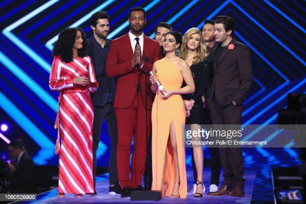 'Shadowhunters' cast members accept The Show of 2018 award on stage during the 2018 E People's Choice Awards held at the Barker Hangar on November 11...