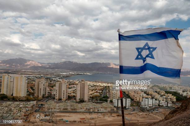 A pictured shows the southern Israeli Red Sea resort city of Eilat and Jordan's Red Sea resort city of Aqaba in the background on April 17 2020 amid...