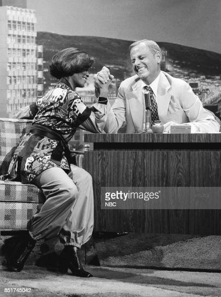 Singer Dionne Warwick arm wrestles during an interview with guest host McLean Stevenson on October 18 1976