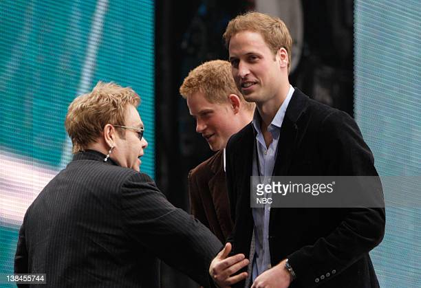 Singer Elton John speaks with Prince Harry and Prince William on stage during the 'Concert for Diana' held at Wembley Stadium Wembley London England...