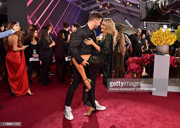 Steven Perkins and Desi Perkins arrive to the 2019 E People's Choice Awards held at the Barker Hangar on November 10 2019 NUP_188994