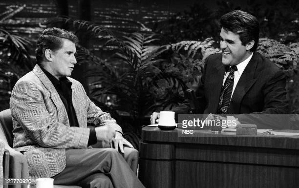Pictured: Talk show host Regis Philbin during an interview with guest host Jay Leno on September 19, 1990 --