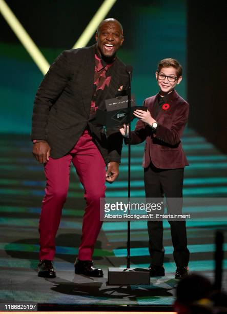 Terry Crews and Jacob Tremblay speak on stage during the 2019 E People's Choice Awards held at the Barker Hangar on November 10 2019 NUP_188997