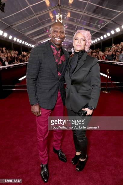 Terry Crews and Rebecca KingCrews arrive to the 2019 E People's Choice Awards held at the Barker Hangar on November 10 2019 NUP_188990