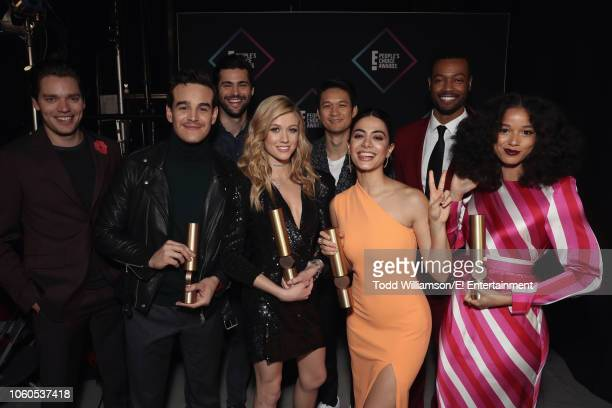 The cast of 'Shadowhunters The Mortal Instruments celebrate winning the Show of 2018 award backstage during the 2018 E People's Choice Awards held at...
