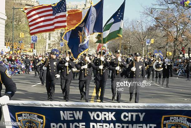 The New York City Police Department colorguard and band marches during the 1997 Macy's Thanksgiving Day Parade Photo by NBCU Photo Bank