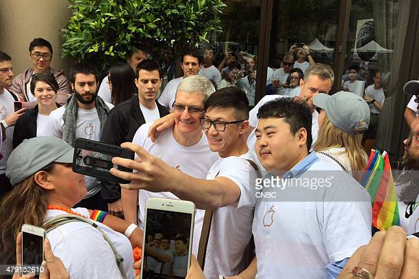 Tim Cook CEO of Apple Inc poses for selfies at the Pride Parade in San Francisco CA on June 28 2015