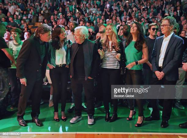 Pictured together bathed in some of the green lighting used during pre game player introductions and ceremonies are Boston Celtics owner Wyc...