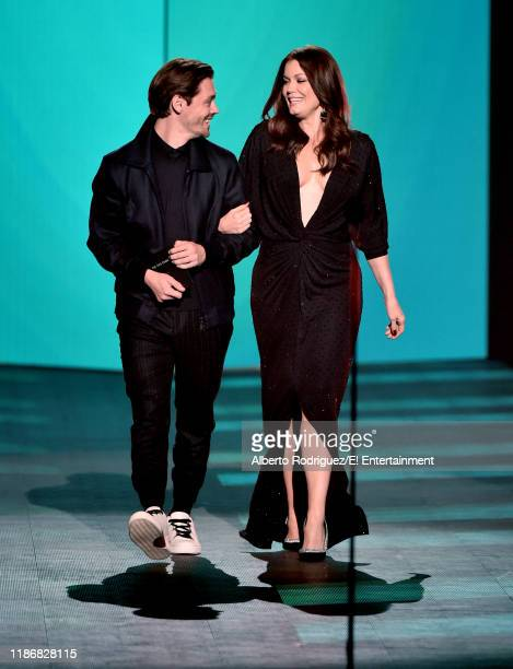 Tom Payne and Bellamy Young speak on stage during the 2019 E People's Choice Awards held at the Barker Hangar on November 10 2019 NUP_188997