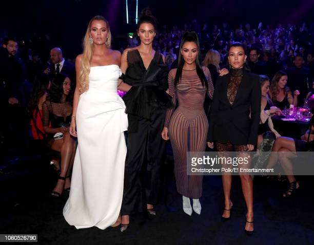 TV personalities Khloe Kardashian Kendall Jenner Kim Kardashian West and Kourtney Kardashian pose during the 2018 E People's Choice Awards held at...