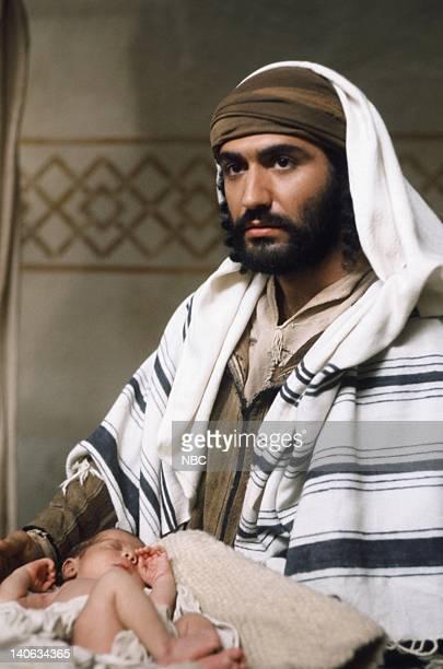 Unknown as baby Jesus Yorgo Voyagis as Joseph Photo by NBC/NBCU Photo Bank