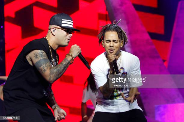 Wisin and Ozuna perform during rehearsals at the Watsco Center in the University of Miami Coral Gables Florida on April 26 2017