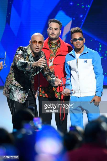 "Pictured: Wisin, Reik and Ozuna, winner of the ""Latin Pop Song of the Year"" award, at the Mandalay Bay Resort and Casino in Las Vegas, NV on April..."