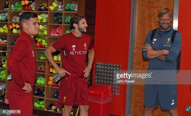 Pictured with Jurgen Klopp manager of Liverpool is Adan Lallana and Philippe Coutinho of Liverpool on their return to Melwood for their first day...