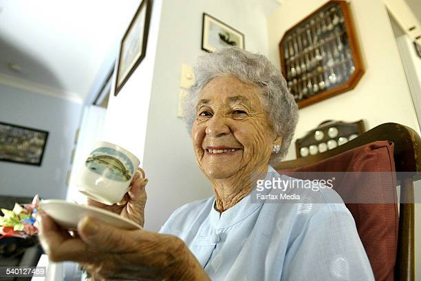 Pictured with the tea set she was given at the opening of the harbour bridge is Catherine Spalding who walked the bridge that day as well as on the...