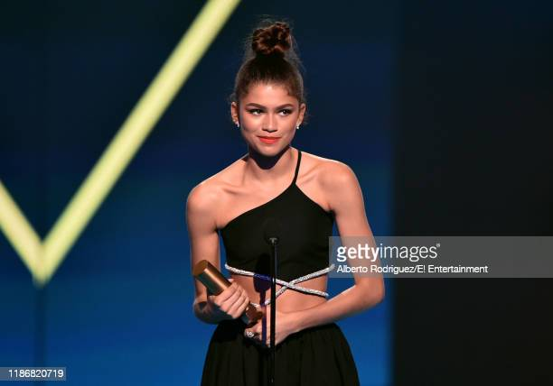Zendaya accepts the The Female Movie Star of 2019 award for SpiderMan Far From Home on stage during the 2019 E People's Choice Awards held at the...