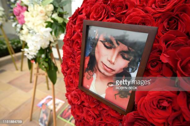 TOPSHOT Pictures and flowers placed by fans gathered outside Michael Jackson's final resting place at the Holly Terrace mausoleum in Forest Lawn...